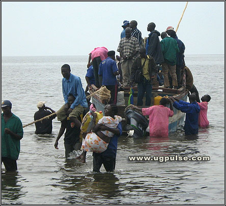 At Kasenyi: Carrying passengers to the shore