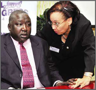 Kigozi consults Oryem at the Home is Best summit held at Hotel Africana in Kampala