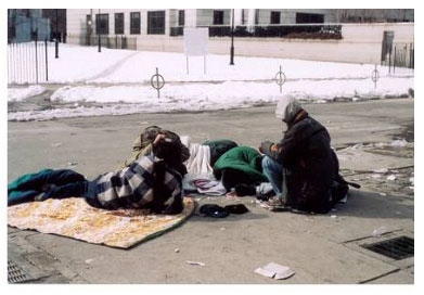 The occasional homeless person, sleeping on the streets with a torn tattered blanket and clothes.