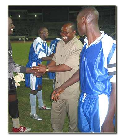 Sc Villa's captain, Andy Musegwa and Sports Minister Charles Bakabulindi congratulating the team.