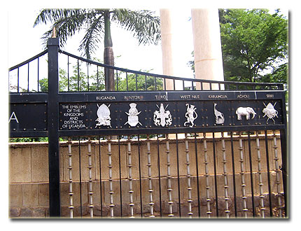 Parliament gate with names and symbols of Uganda's different tribes