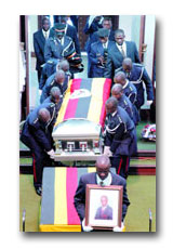 FALLEN HERO: Police officers carry Ayume's body to the Chambers