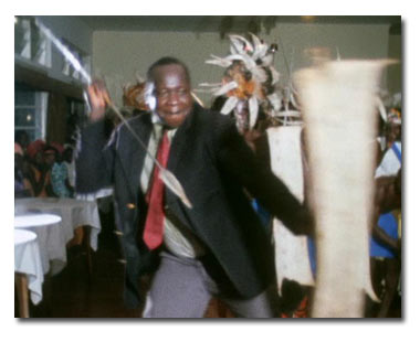 Idi Amin at a function: Taken from Barbet Schroeder's documentary, General Idi Amin Dada (Self Portrait)