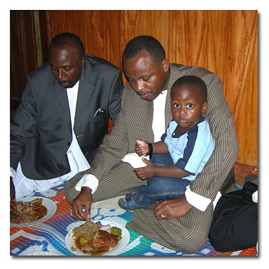 Abdul and Son at traditional lunch in Kawempe (Mariam's Home)