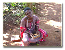 Kinobe playing the Akogo (Thumb piano)