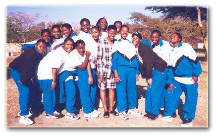 Nancy Oloro in the center as patron with members of the Drama club of Banani International School in Zambia