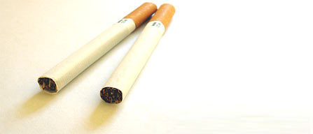 Why do tobacco firms thrive in developing countries despite the industrys health concerns?